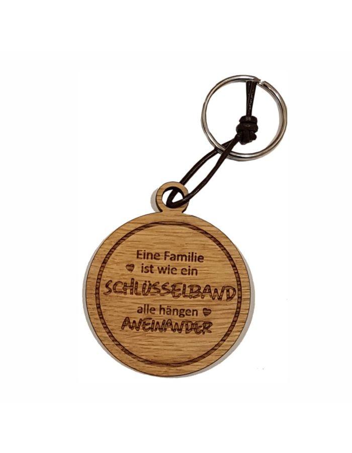 """Schlüsselanhänger aus Holz """"Familie ist wie ein Schlüsselband"""" (rund)"""